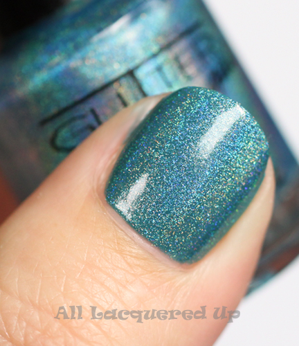 cult nails let me fly nail polish swatch with glitter gal holographic blue layered on top